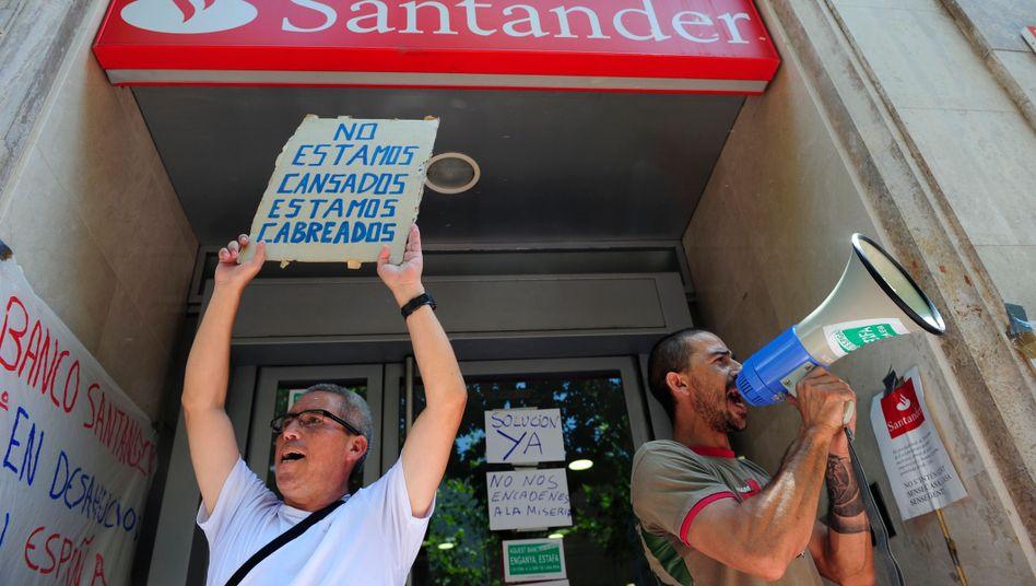 Spanische Santander-Filiale: Das Risiko für die Banken übernimmt der Schirm