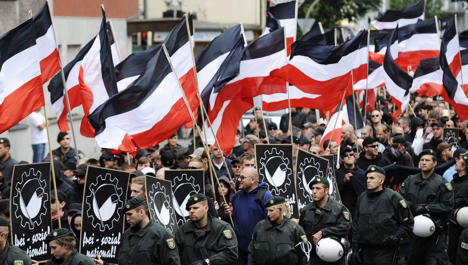 Neo-Nazis march under police protection in Dortmund in 2008.