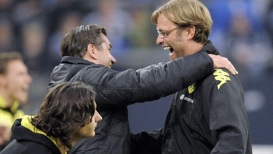 BVB-Trainer Klopp (r.), Sportdirektor Zorc: Verträge verlängert