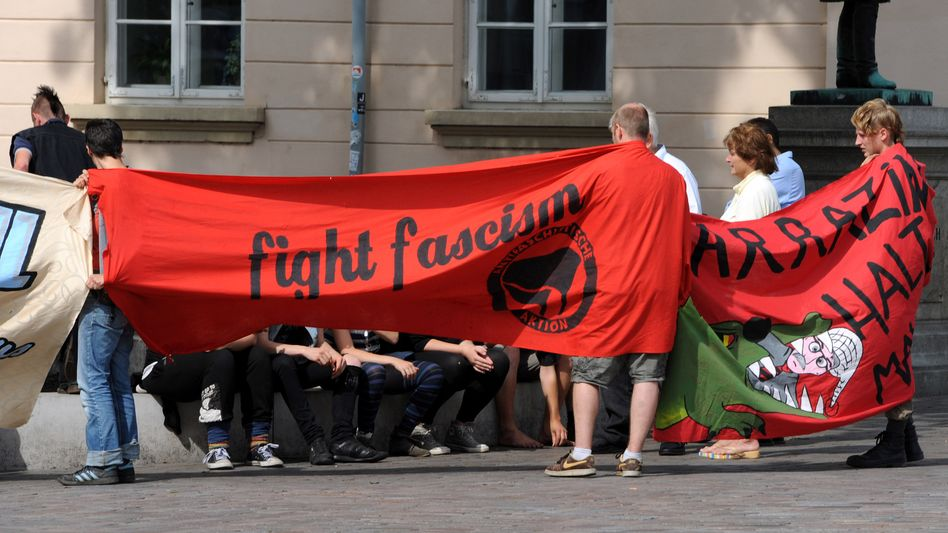 """Demonstrators hold up a banner that reads """"fight fascism"""" ahead of a campaign appearance by the head of euroskeptic party Alternative for Germany earlier this month."""