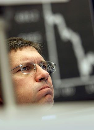 A trader in Frankfurt watches anxiously as the effects of a government rescue plan of Hypo Real Estate affects the German market.