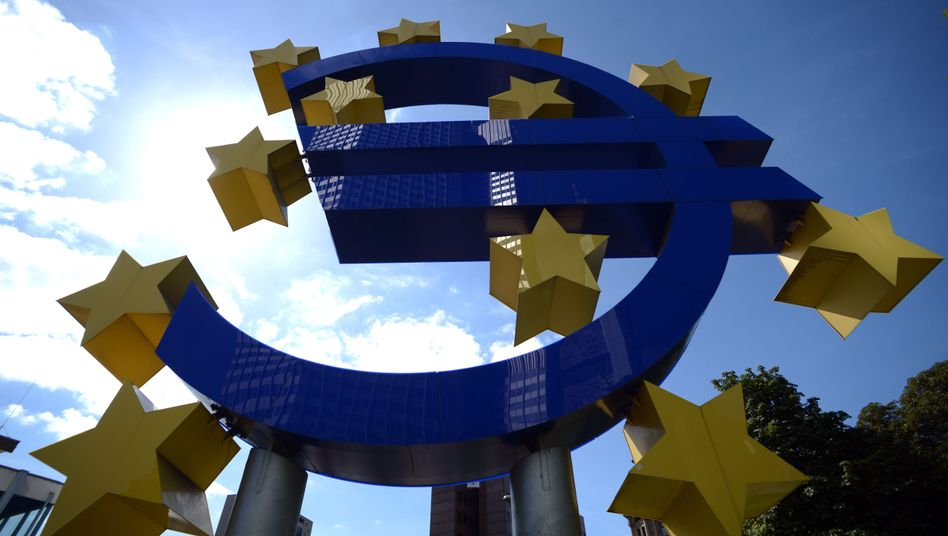 A sculpture of the euro symbol stands in front of the European Central Bank headquarters in Frankfurt: The ECB is pulling out the bazooka to save the common currency.