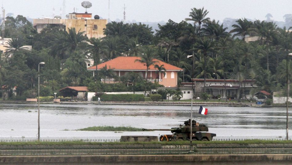 A French tank crosses General de Gaulle bridge in Abidjan, Ivory Coast, on Tuesday.