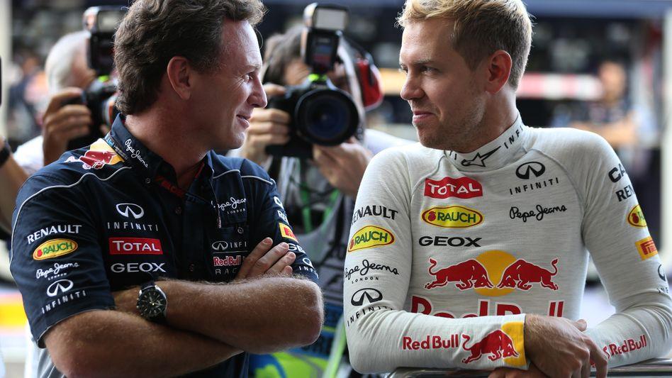 "Red-Bull-Teamchef Horner (l.), Weltmeister Vettel: ""Große Belastung"""