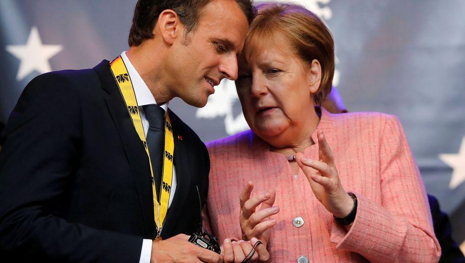 French President Emmanuel Macron and German Chancellor Angela Merkel