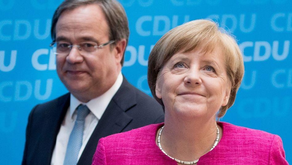Laschet, Merkel (Archiv)