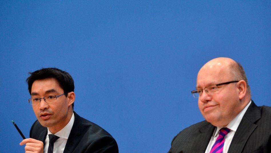 Wirtschaftsminister Rösler und Umweltminister Altmaier: Einig über Fracking-Gesetz