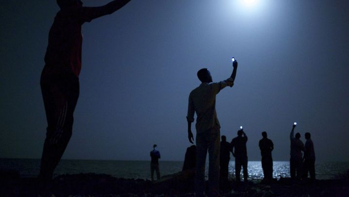 World Press Photo: Handyleuchten in der Nacht
