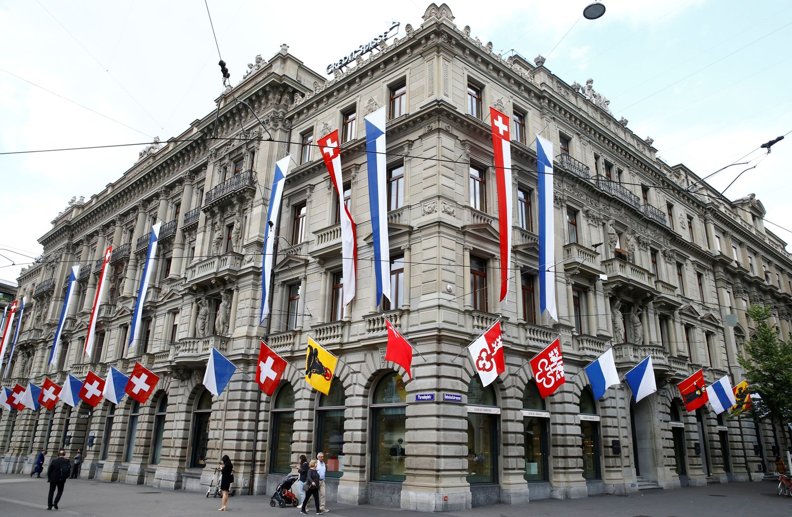 Switzerland's national flag and flags of the Swiss cantons fly at the headquarters of Swiss bank Credit Suisse in Zurich