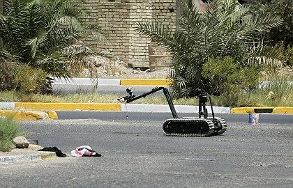 A US Army robot defuses an improvised explosive device (IED) found during a patrol in Baghdad.