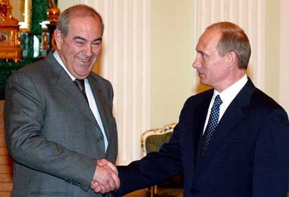 Russian President Vladimir Putin (right) and Iraqi Interim President Ayad Allawi. Putin: Your country is falling apart!