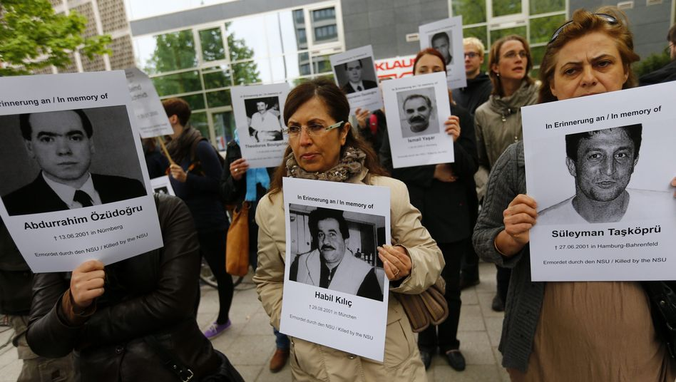 Demanding answers: Protestors in Munich call for clarification of the true nature of the German neo-Nazi killing spree.