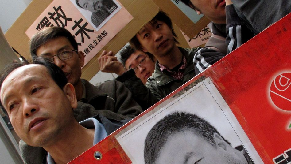 Protesters rallied in Hong Kong Tuesday for the release of Ai Weiwei.