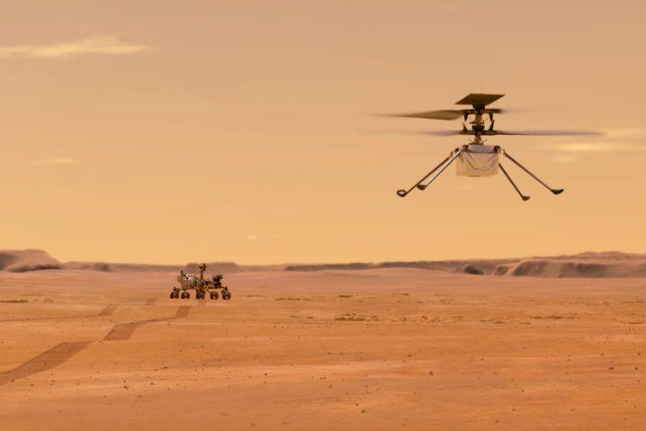 Von der Nasa zur Verfügung gestellte Illustration: So sieht es aus, wenn »Ingenuity« auf einen Erkundungsflug geht. Im Hintergrund: der Marsrover »Perseverance«
