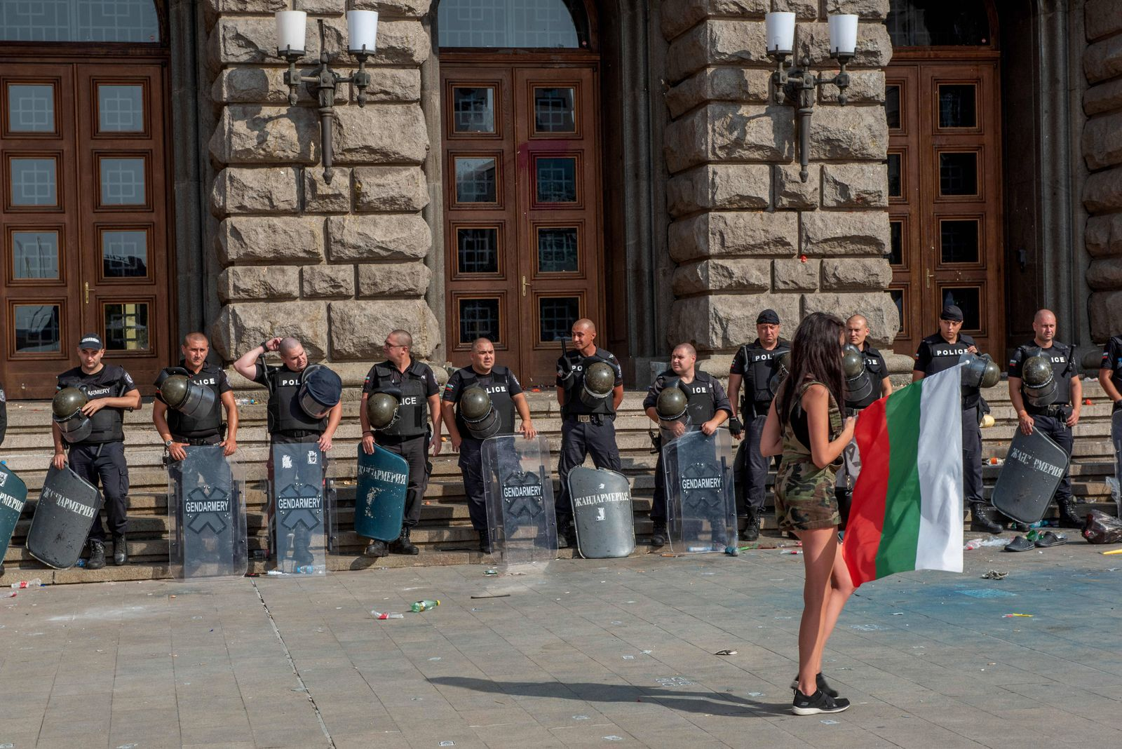 September 2, 2020, Sofia, Bulgaria: Riot police stand on guard facing off with a female protester during the demonstrati