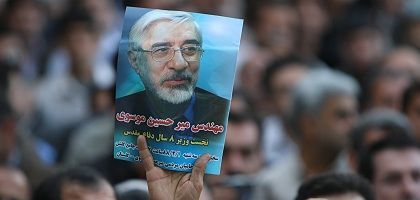 An Iranian holds up a poster of presidential candidate Mir Hossein Mousavi at a mosque in Ghorghan, Iran.