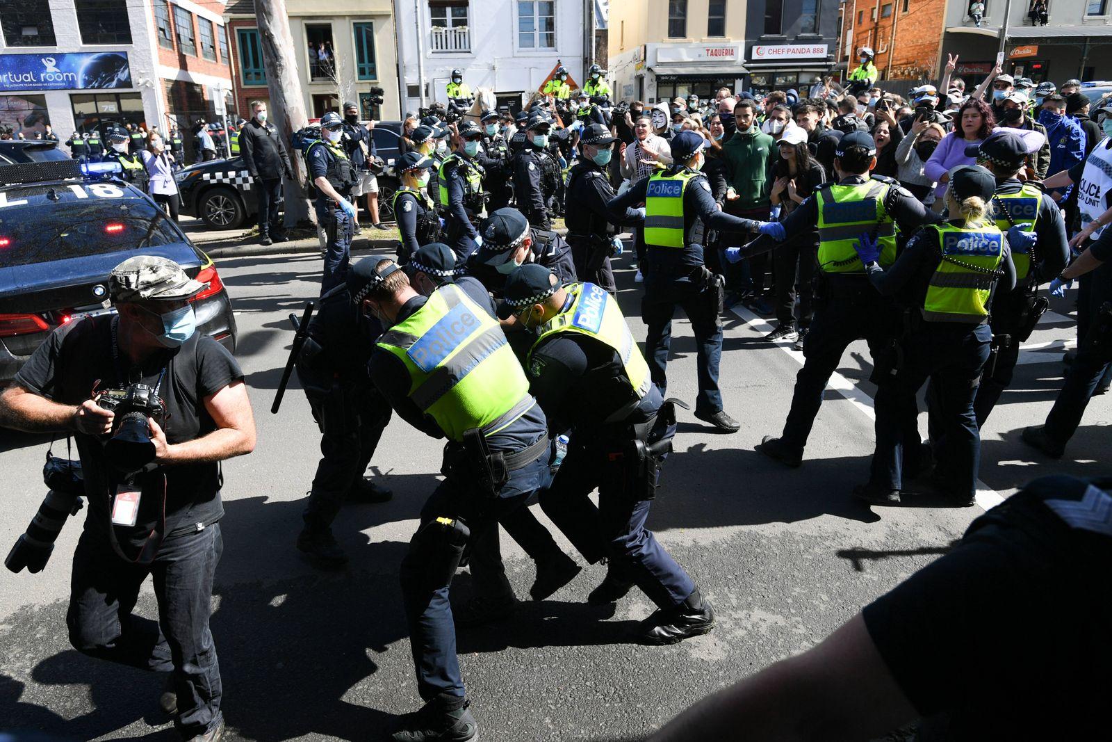 ANTI LOCKDOWN PROTEST MELBOURNE, Police scuffle with protesters during an anti-lockdown protest in Melbourne, Sunday, S