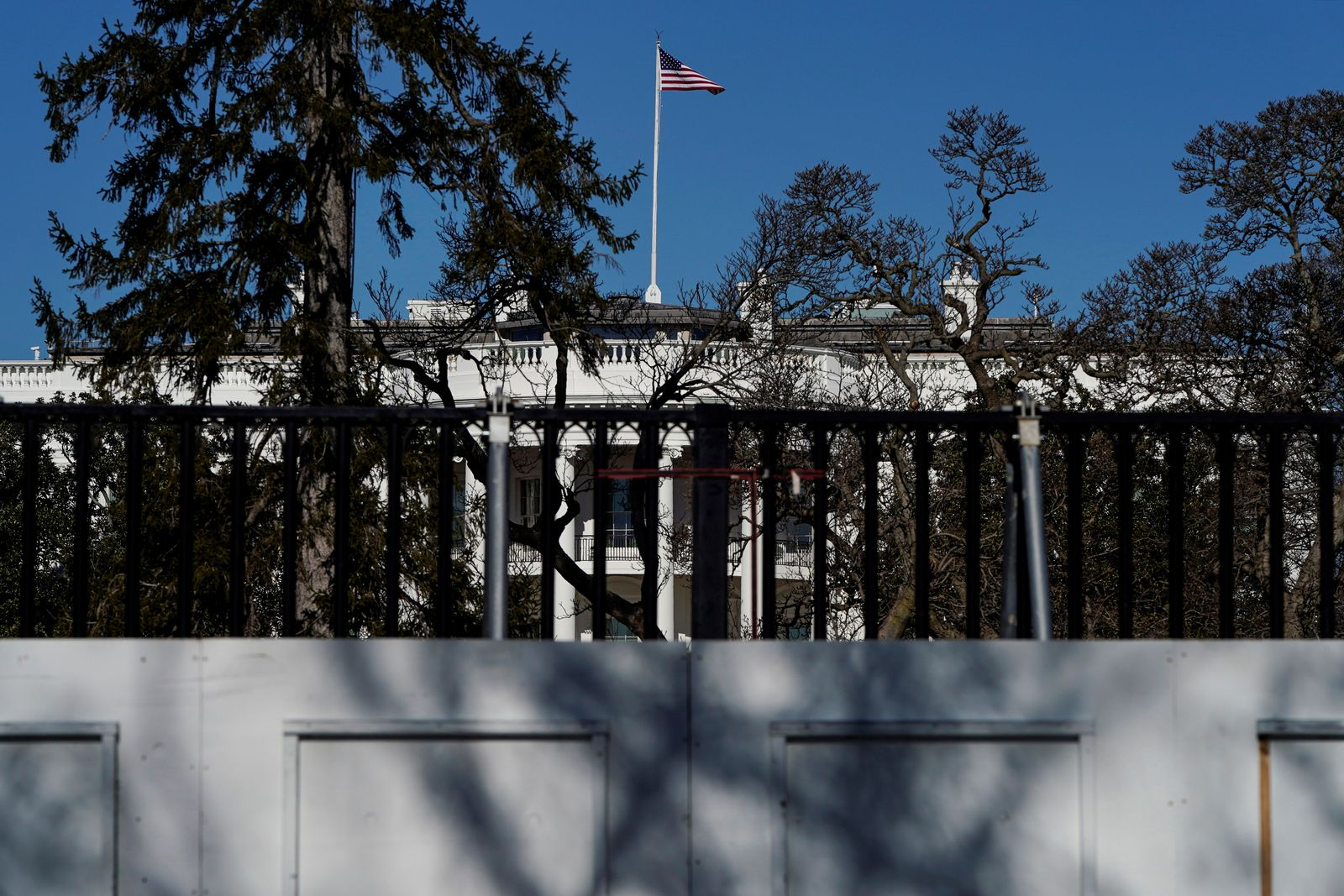 The White House is seen behind security fencing in Washington