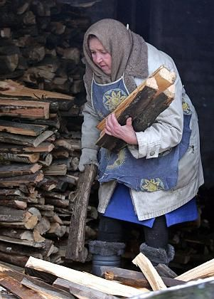 Russia is rich in natural gas, but many poor villagers are forced to heat their homes with 19th century wood-burning stoves.