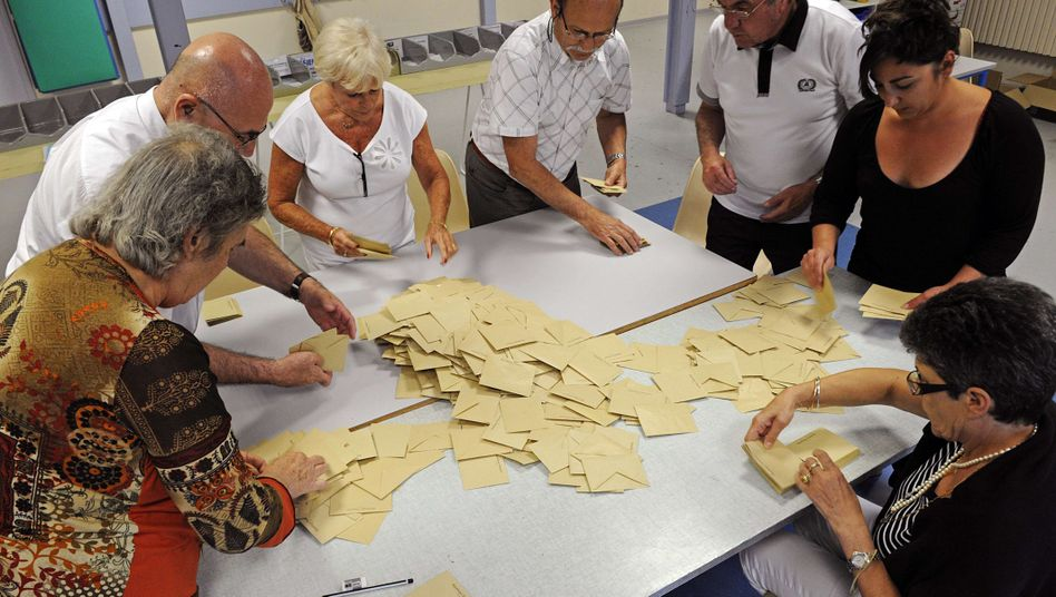 Volunteers count votes at a polling station in Marseille in southern France. While a runoff is necessary, first round results show that the Socialist Party and its allies are set to win 40 percent of the votes for the French National Assembly.