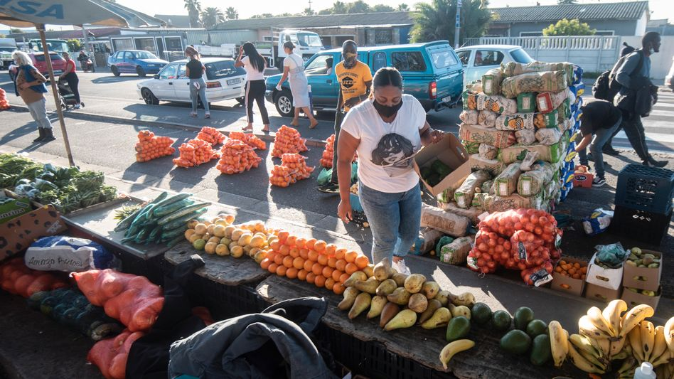 Michelle Davids doing her shopping in Cape Town, South Africa. She hardly afford to buy vegetables any longer.