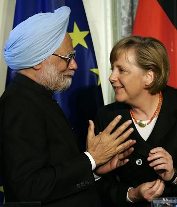 Indian Prime Minister Manmohan Singh talks to German Chancellor Angela Merkel during Singh's April 2006 visit to Germany. Merkel arrived in India Monday for a four-day visit.
