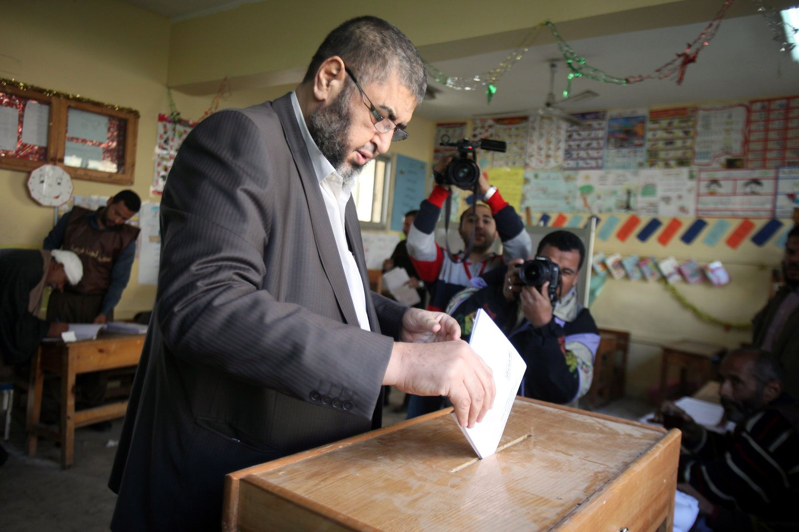 Egyptians vote for the first round Parliamentary elections in Cai