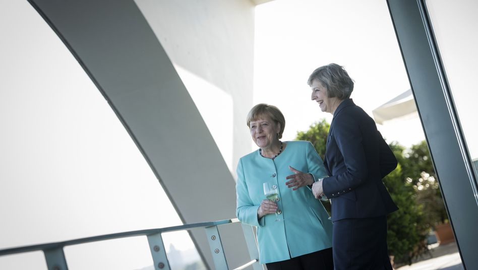 Angela Merkel and Theresa May at their first official meeting in Berlin on July 20.
