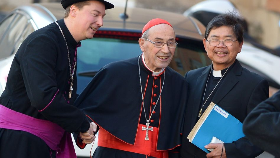 Ralph Napierski (L), poses with cardinal Sergio Sebiastiana outside pre-conclave talks to elect a new pope at the Vatican.