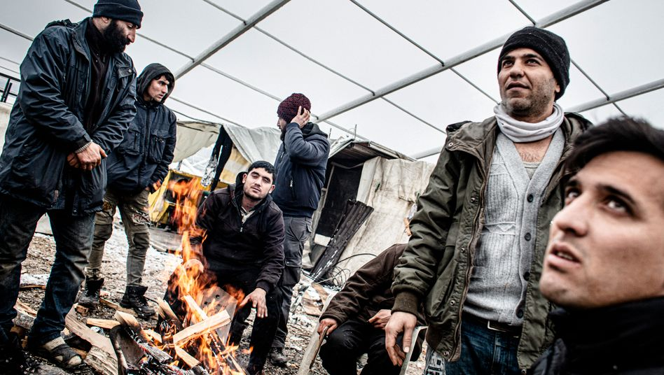 Refugees in the destroyed Lipa camp