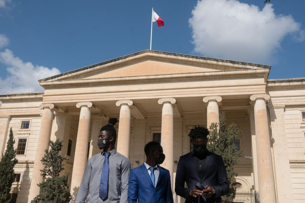 Defendants Kader, Lamin and Abdalla in front of the courthouse in Valletta.