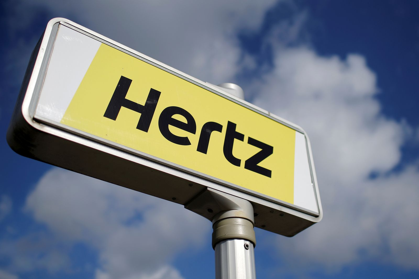 FILE PHOTO: The logo of the American car rental company Hertz is seen at the Nantes-Atlantique airport in Bouguenais near Nantes