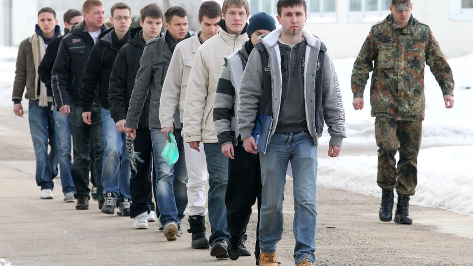 The German army's last conscripts showed up for duty on Monday, including these men in the city of Neubrandenburg.