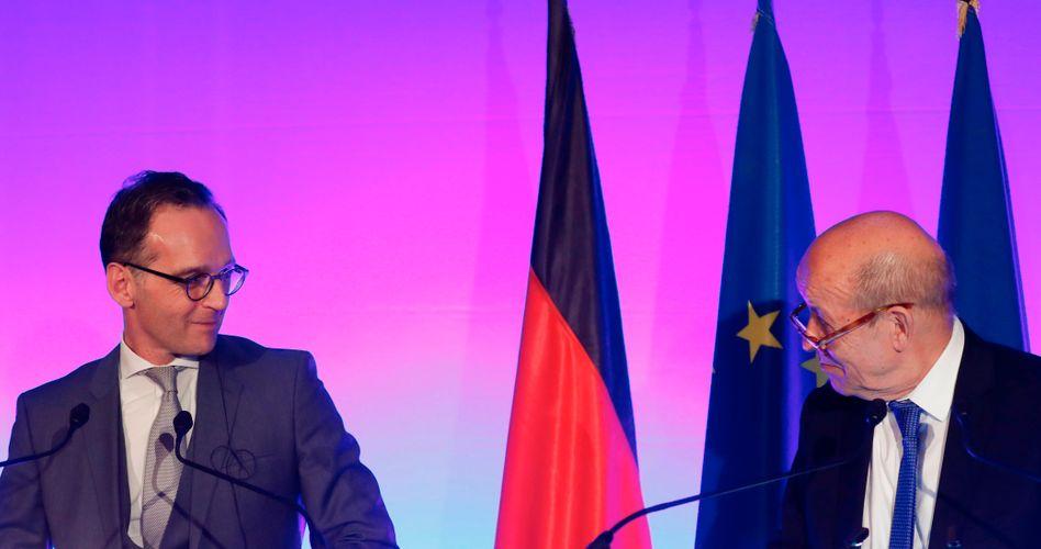 Außenminister Heiko Maas (l.) mit seinem französischen Amtskollegen Jean-Yves Le Drian