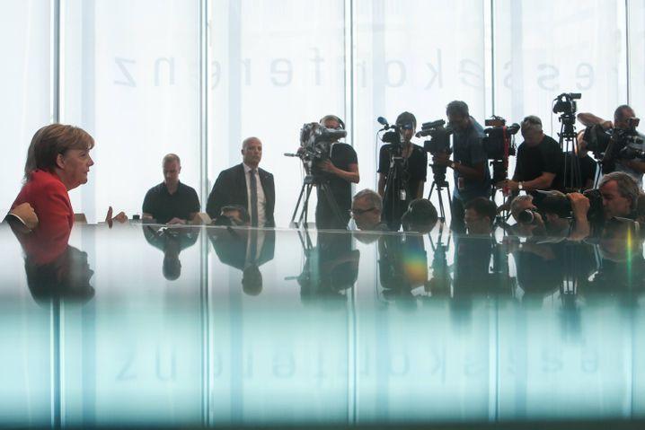 Merkel bei ihrer Sommerpressekonferenz im Jahr der Flüchtlingskrise 2015