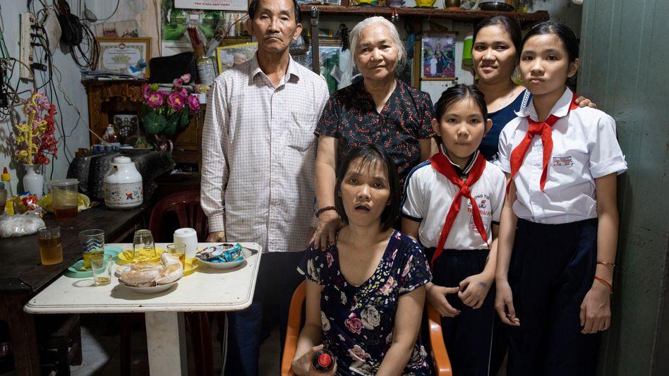 Nguyen Van Bat with his wife, two daughters and two grandchildren