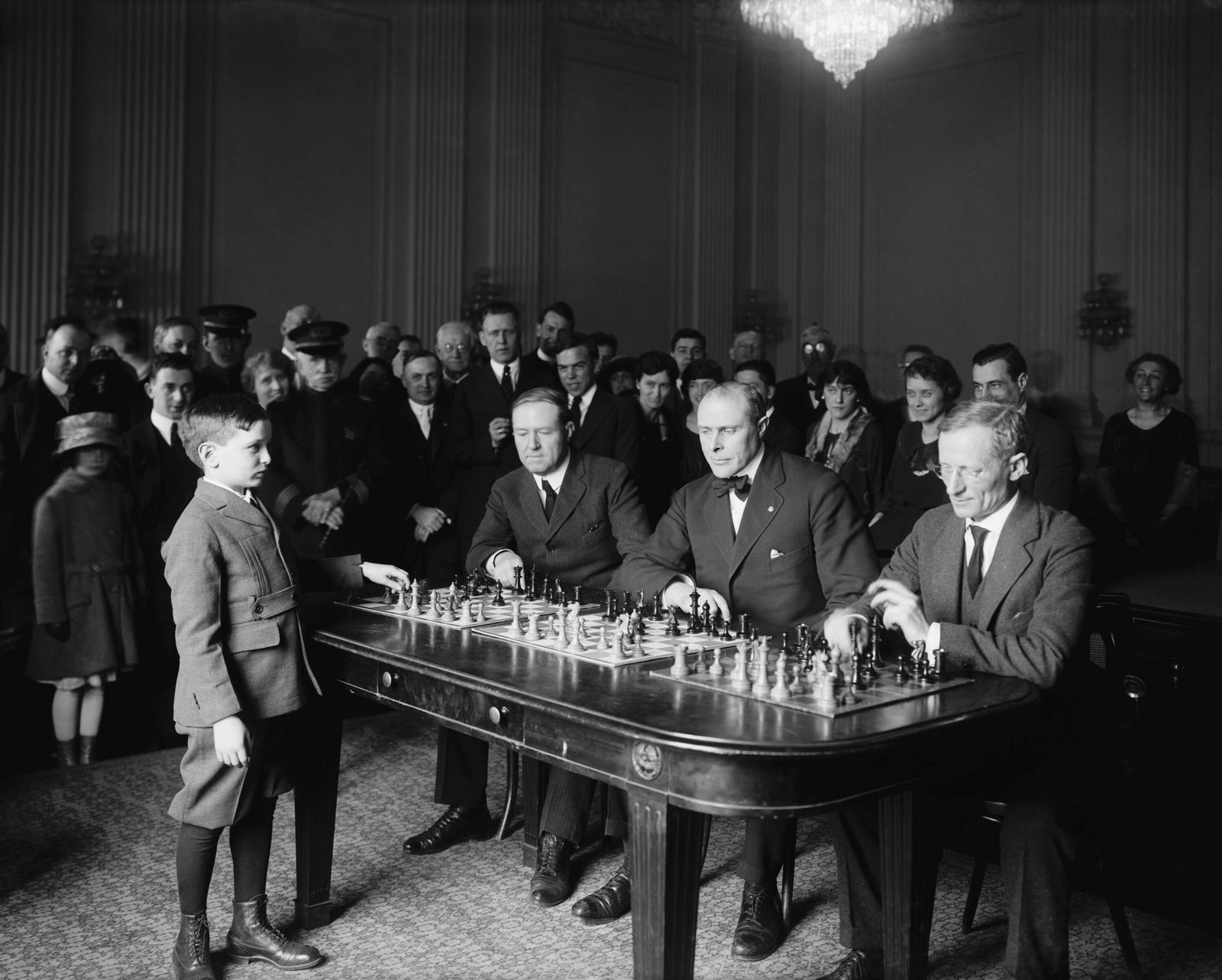 Chess prodigy, Samuel Herman Reshevsky, in a simultaneous chess exhibition match, April 6, 1922. The 10 year old was on