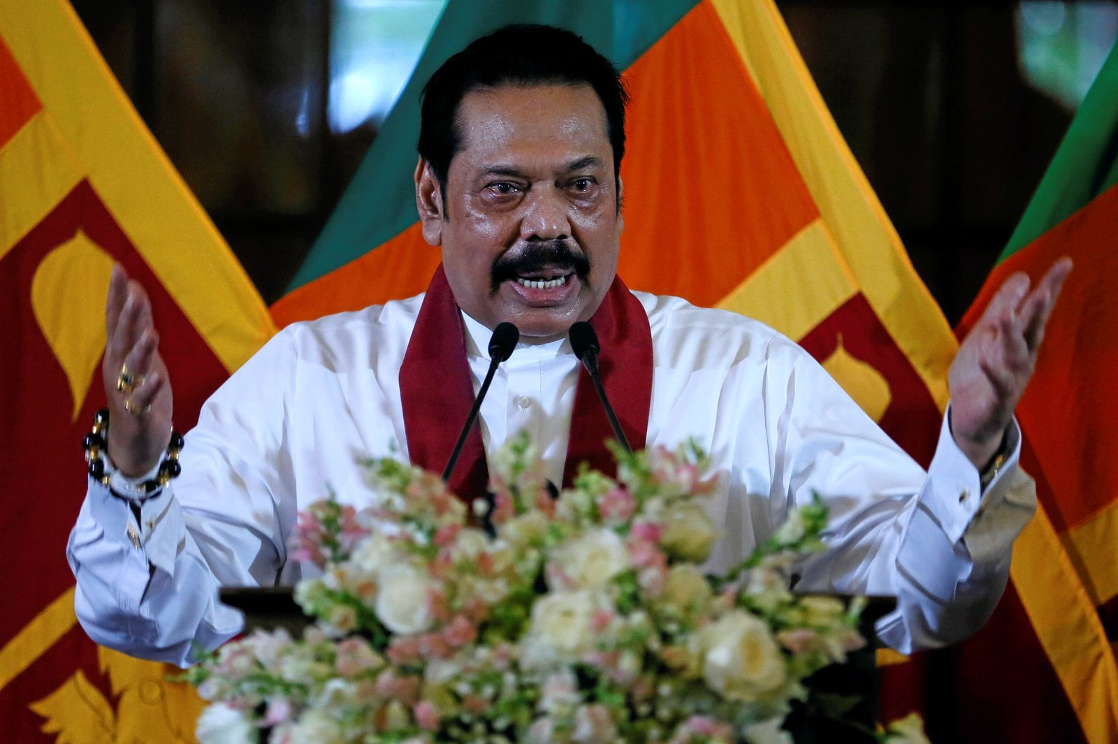 Sri Lanka's newly appointed Prime Minister Rajapaksa addresses the gathering during the ceremony to assume his duties as the Minister of Finance and Economic Affairs at the Finance Ministry in Colombo
