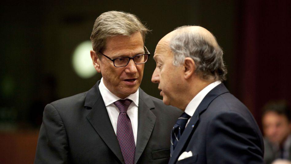 Außenminister Westerwelle und sein französischer Amtskollege Fabius: Treffen in Brüssel