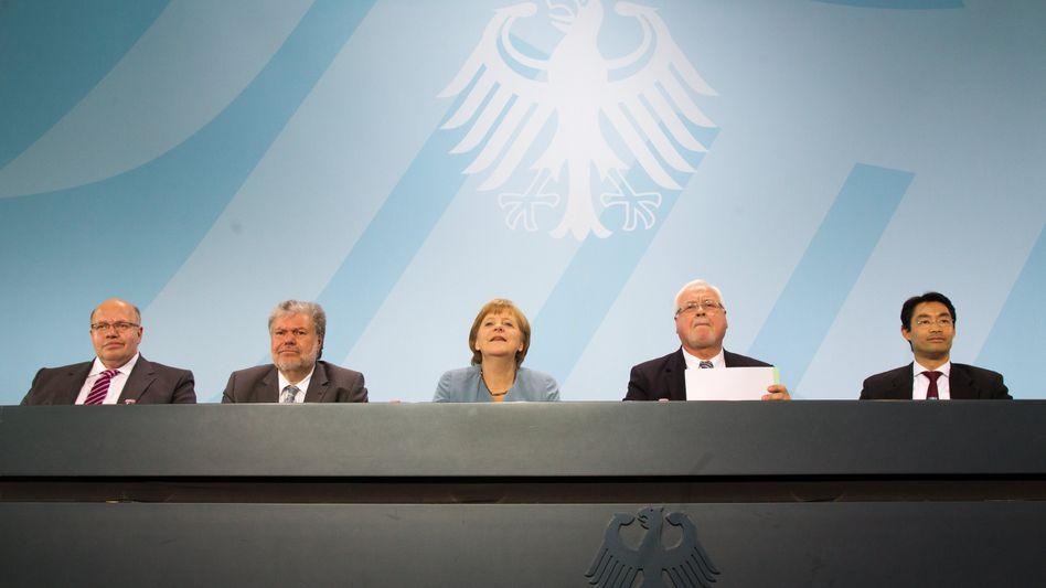 Altmaier, Beck, Merkel, Carstensen, Rösler (v.l.n.r.): viele Versprechen, wenige Beschlüsse