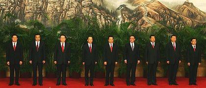 China's Communist Party unveiled its new Politburo Standing Committee in Beijing Monday. From left: Zhou Yongkang, Li Keqiang, Li Chuangchun, Wen Jiabao, Hu Jintao, Wu Bangguo, Jia Qinglin, Xi Jinping and He Guoqiang.