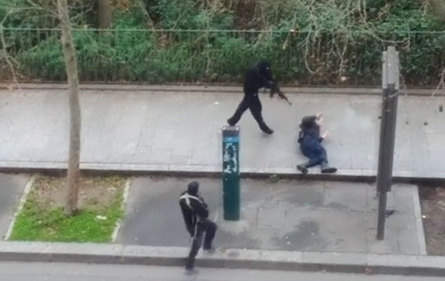 Still image taken from amateur video shows gunmen shooting a wounded police officer outside the offices of French satirical newspaper Charlie Hebdo in Paris