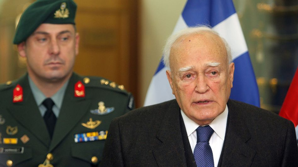 President Karolos Papoulias addresses journalists on Wednesday in Athens.