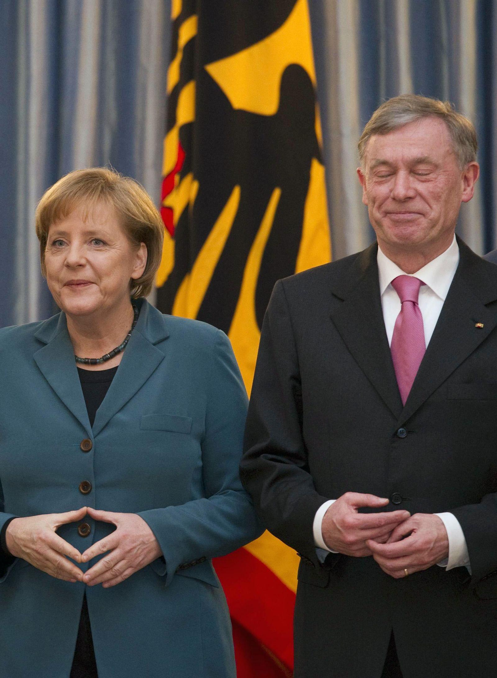 NICHT VERWENDEN Merkel, Koehler schmunzeln