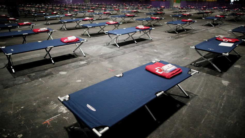 Beds set up in an exhibition hall in Madrid.