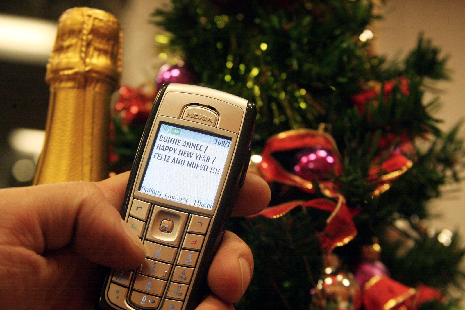Frankreich / Mobiltelefon / Neujahr