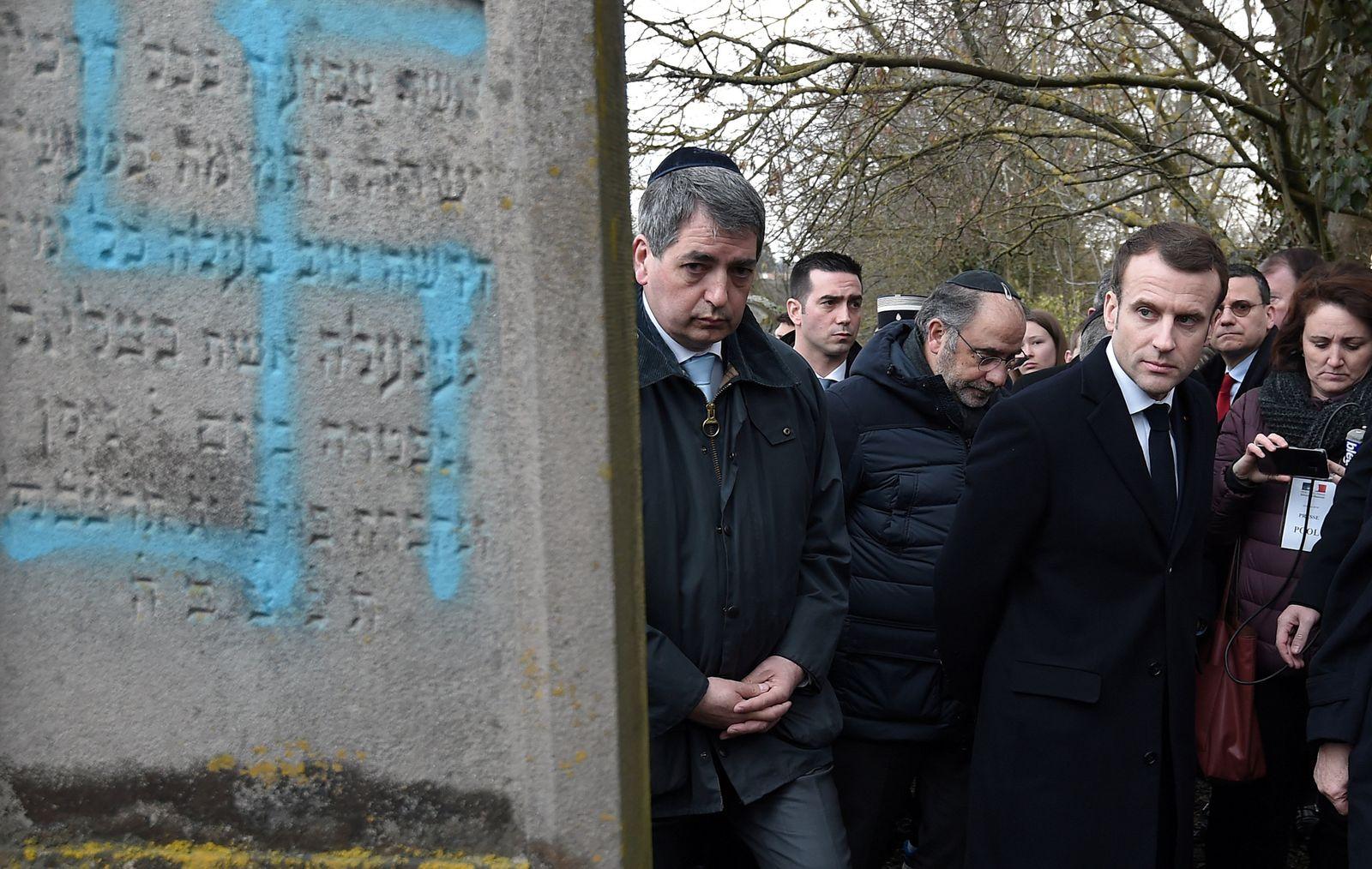 FILE PHOTO: French President Emmanuel Macron visits a Jewish cemetery in Quatzenheim