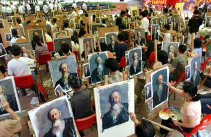 Painters compete during a facsimile match in Dafen Village. More than 110 contestants make facsimile of portrait or scenery oil painting in the timed match.