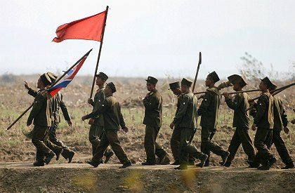 North Korean soldiers on their way to a construction site on the banks of the Yalu River.