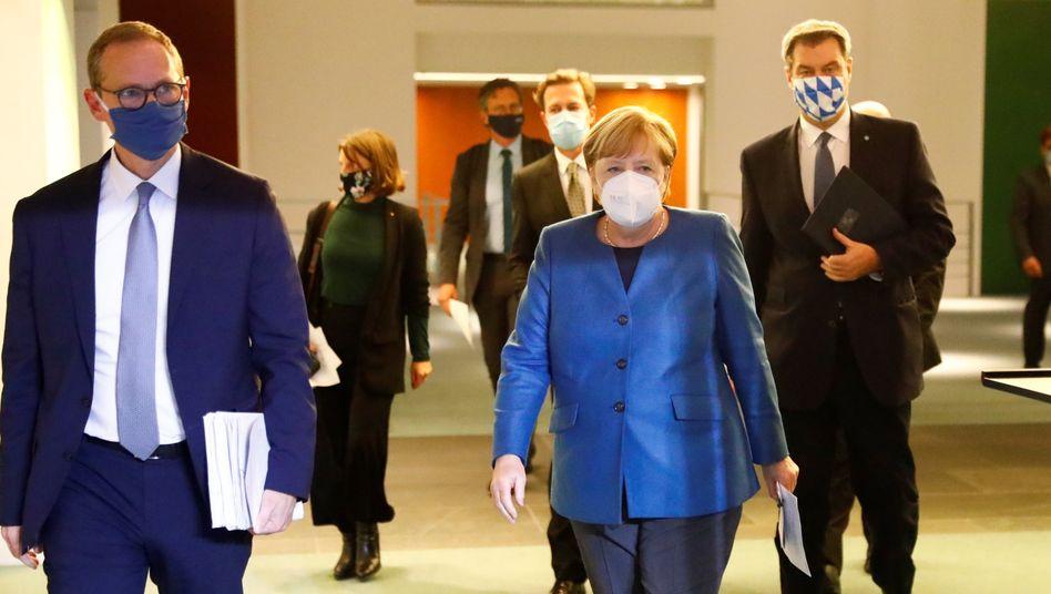 Michael Müller, Angela Merkel, Markus Söder